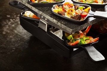 Scrumptious raclette with veggies and seafood