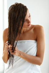 Hair Care. Beautiful Woman With Wet Hair In Towel After Bath