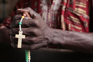 Man praying with rosary, Cotonou, Benin, West Africa