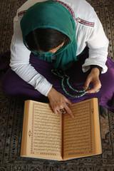 Muslim woman reading Kuran, Montrouge, Hauts-de-Seine, France, Europe