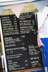 Coffee shop menu on a blackboard.