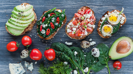 tasty and delicious bruschetta with with vegetables, cheese and micro greens