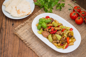 Vegetable stew with meat. Wooden background. Top view. Close-up