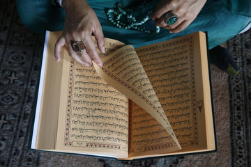 Muslim woman reading Kuran, Montrouge, Hauts-de-Seine, France