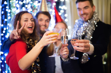 Group of friends having party on New Years Eve.