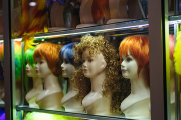 Mannequins in a shop window with colored hair