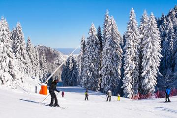 Panorama of ski resort, slope, people, mountain view at winter time