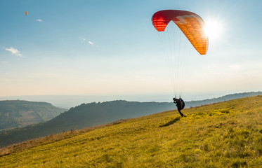 Foto op Aluminium Luchtsport Paraglider in sunny day flying in Palava, hill Devin, South Moravia, Czech Republic