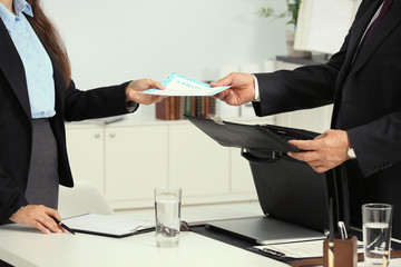 Young woman with notary at office