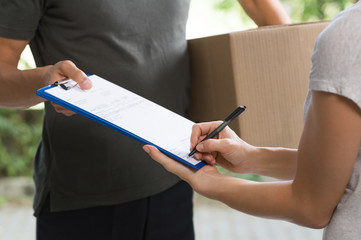 Woman signing delivery form