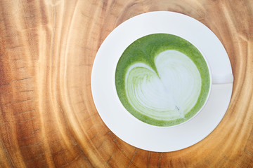 Top view of Japanese matcha green tea latte with heart shaped mi