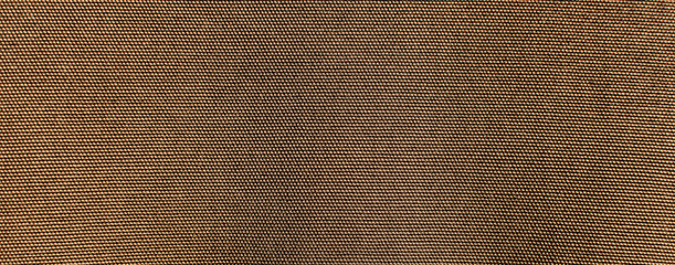 the textured background or wallpaper of rough cotton fabric of khaki color