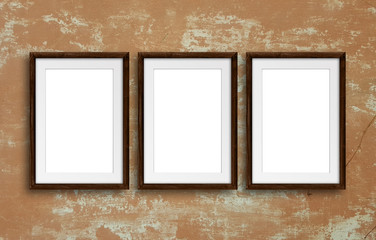 Three brown photo frames on old plastered wall, exhibition template, retro style decor mock up