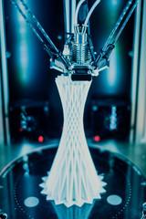 3D printer printing plastic tower