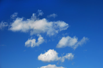The white clouds on the blue sky as an illustration