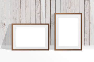 Two blank photo frames near old painted wooden panels wall, countryside style decor, interior mock up