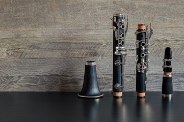 Dismantled Clarinet on a Black Table