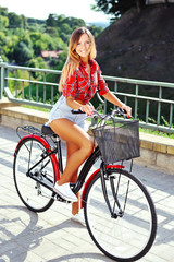 Pretty young girl on a bicycle