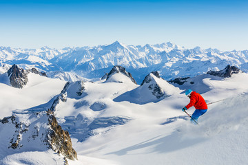 Skier skiing downhill Valle Blanche in french Alps in fresh powd