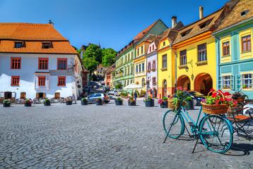 Famous medieval street cafe bar,Sighisoara,Transylvania,Romania,Europe