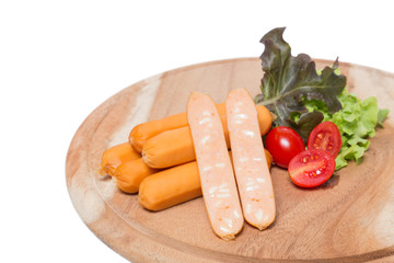 Cheese sausages on the wood board with fresh vegetable