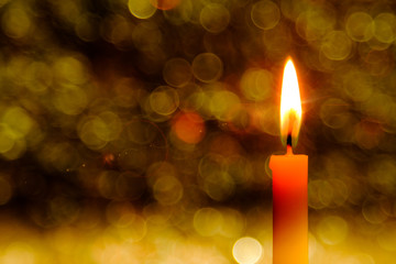 lighting flare effect on Candle flame light at night with abstract circular bokeh background Christmas lights.