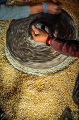 Spinning corn grinder