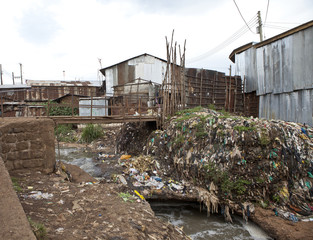 Filthy slum with rubbish and bad water