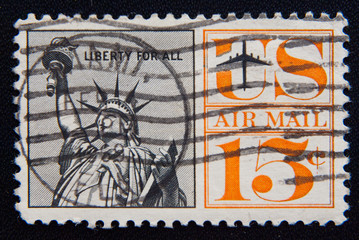 MOSCOW RUSSIA - NOVEMBER 25, 2012: A used postage stamp from the USA, depicting an illustration of the Statue of Liberty, circa 1961