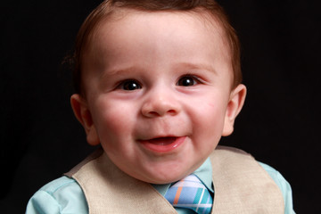 Cute Happy Smiling Little Boy Child Infant Baby In A Blue and Tan Formal Suit
