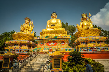 Three golden statues