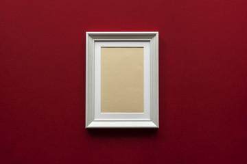 little white wooden frame on red vinous background
