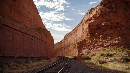 railroad tracks between high rock walls  Wall mural