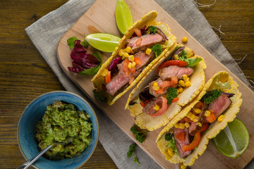 Tacos with beef, pepper and guacamole