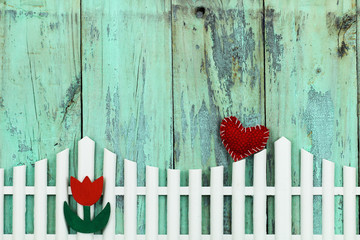 Blank wood sign with white picket fence, flower and red heart
