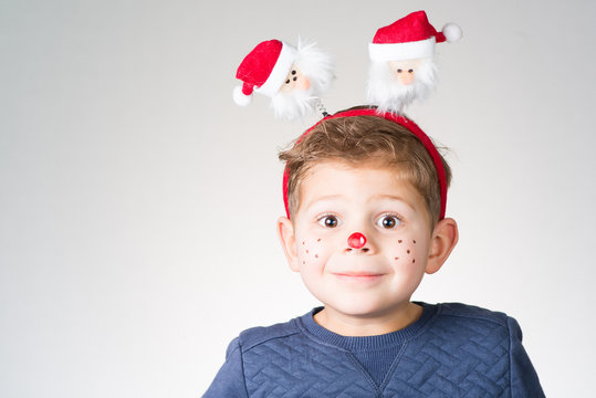 lovely adorable kid with paintings on his face for Christmas