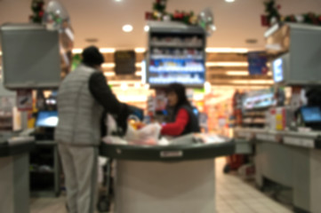 Blurred supermarket interior with cash register