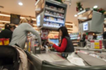 Blurred supermarket interior with cash register