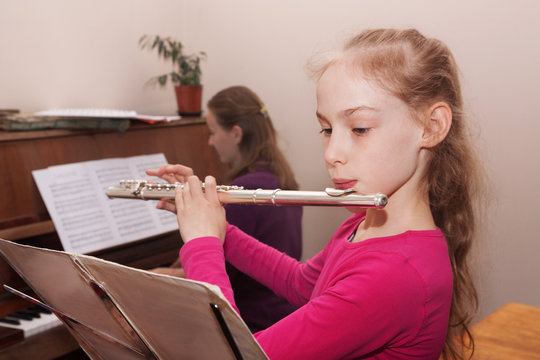 girl learning to play the flute