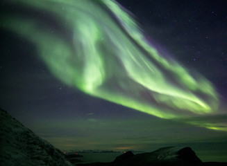 Arctic winter nights with northern lights and stars