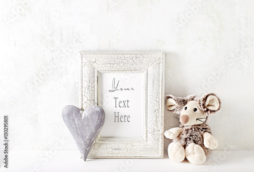 An Arrangement Of A Mascot Wooden Heart And A Picture Frame Stock