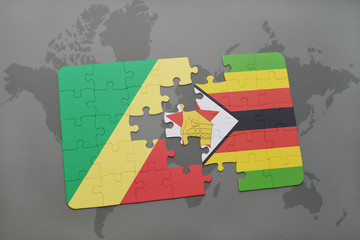 puzzle with the national flag of republic of the congo and zimbabwe on a world map