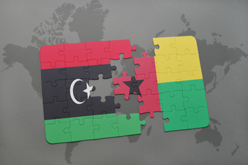 puzzle with the national flag of libya and guinea bissau on a world map
