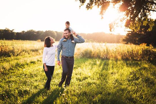 A family having fun in a big open field