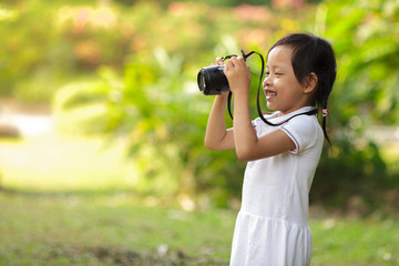 Beautiful child smiling and taking pictures at the nature field.