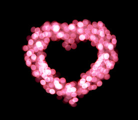 Pink bokeh heart shapes background.