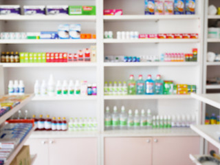 pharmacy store with blur medicines arranged on shelves