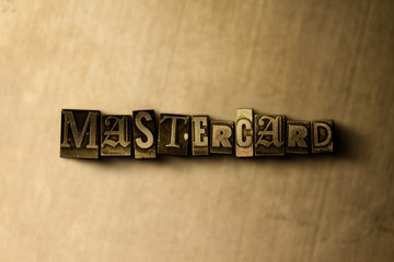 MASTERCARD - close-up of grungy vintage typeset word on metal backdrop. Royalty free stock illustration.  Can be used for online banner ads and direct mail.