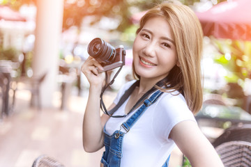 cute teenage asian girl with camera outdoor (selective focus) tr