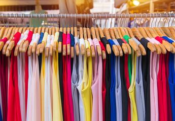 Colorful clothes fashion hang on a shelf at flea market shopping